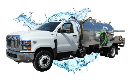 1500 white cab side view vacuum truck with water splash