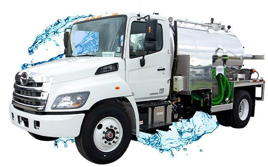2000 white cab vacuum truck with water splash