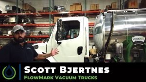 Video still of Scott Bjertnes of FlowMark Kansas City in front of vacuum truck
