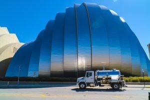 white cab vacuum truck in front of Kauffman Center in Kansas City