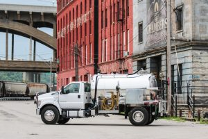 Side view of vacuum truck outside in downtown Kansas City