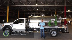 Video still of Andrew Nelson in front of Vacuum truck