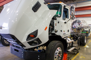 White truck being worked on and turned into vacuum truck at Flowmark warehouse in Kansas City